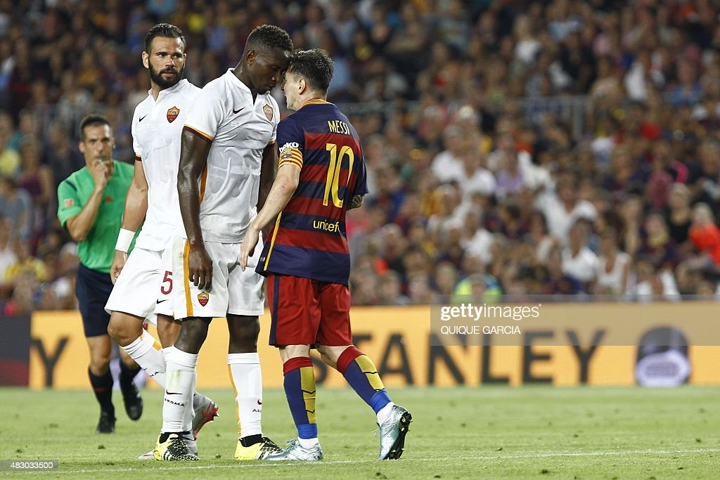 AS Roma's French defender <a gi-track='captionPersonalityLinkClicked' href=/galleries/search?phrase=Mapou+Yanga-Mbiwa&family=editorial&specificpeople=6665294 ng-click='$event.stopPropagation()'>Mapou Yanga-Mbiwa</a> (L) and Barcelona's Argentinian forward <a gi-track='captionPersonalityLinkClicked' href=/galleries/search?phrase=Lionel+Messi&family=editorial&specificpeople=453305 ng-click='$event.stopPropagation()'>Lionel Messi</a> (R) touch heads during the 50th Joan Gamper Trophy football match FC Barcelona vs AS Roma at the Camp Nou stadium in Barcelona on August 5, 2015.