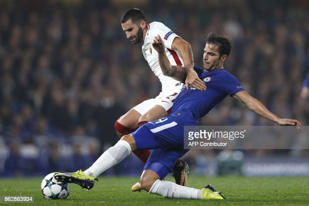 Roma's French midfielder Maxime Gonalons vies with Chelsea's Spanish midfielder Cesc Fabregas during a UEFA Champions league group stage football...
