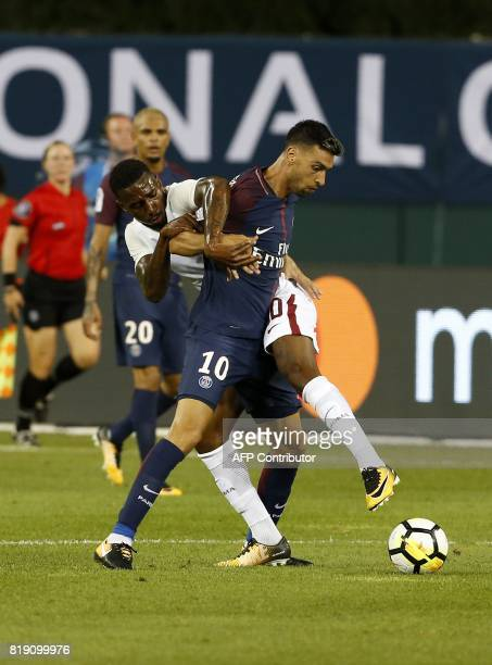 AS Roma's Gerson and Paris SaintGermain's Javier Pastore fight for the ball in their International Champions Cup match on July 19 2017 at Comerica...