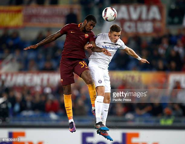 Roma's Gerson left and Austria Wien Jens Stryger Larsen jump for the ball during the Europa League Group E soccer match between Roma and Austria Wien...