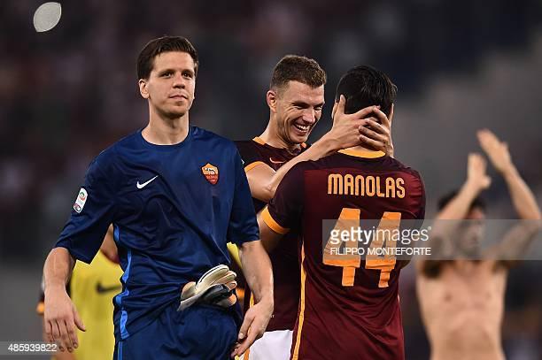 Roma's goalkeeper from Poland Wojciech Szczesny Roma's forward from BosniaHerzegovina Edin Dzeko and Roma's defender from Greece Kostas Manolas...