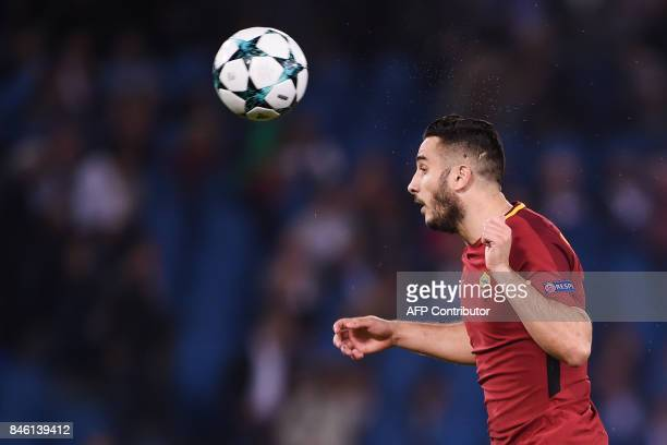 Roma's Greek defender Konstantinos Manolas heads the ball during the UEFA Champions League Group C football match between AS Roma and Atletico Madrid...