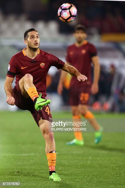 Roma's Greek defender Kostas Manolas eyes the ball during the Italian Serie A football match between Pascara and Roma on April 24 2017 at the...
