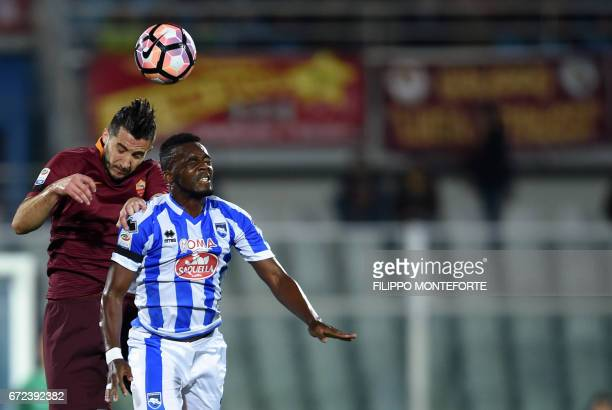 Roma's Greek defender Kostas Manolas vies with Pescara's French forward JeanChristophe Bahebeck during the Italian Serie A football match between...
