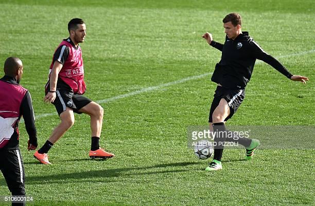 AS Roma's Greek midfielder Kostas Manolas and AS Roma's Bosnian forward Edin Dzeko attend a training session on February 16 2016 at Roma's training...