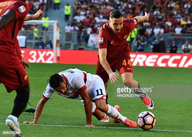 AS Roma's Greek midfielder Kostas Manolas vies Genoa's forward Raffaele Palladino during the Italian Serie A football match AS Roma vs Genoa on May...