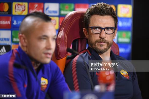 AS Roma's headcoach Eusebio Di Francesco listens to AS Roma's midfielder from Belgium Radja Nainggolan during a press conference on the eve of the...