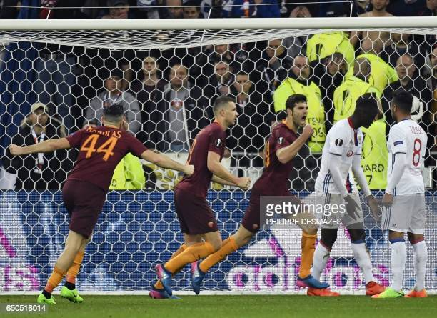 Roma's Italian defender Federico Fazio reacts after scoring next to Roma's Bosnian forward Edin Dzeko and Roma's Greek defender Konstas Manolas...