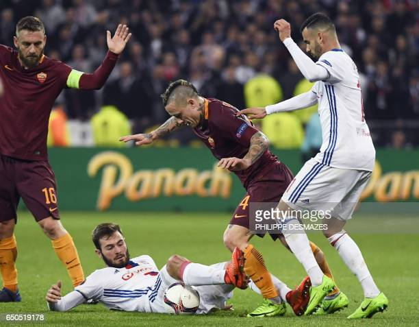 Roma's Italian forward Daniele De Rossi and Roma's Belgium midfielder Radja Nainggolan vies with Lyon's French Algerian midfielder Rachid Ghezzal and...