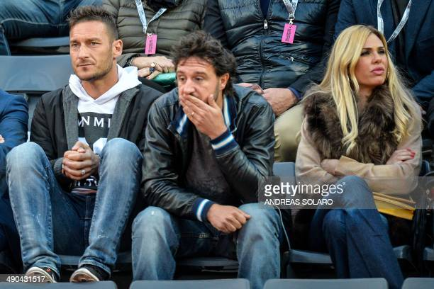 AS Roma's Italian forward Francesco Totti and his wife Ilary Blasi attend the Rome Masters tennis match between Spain's Rafael Nadal and France's...