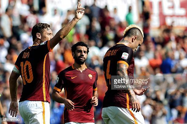Roma's Italian forward Francesco Totti celebrates after scoring a goal during the Italian Serie A football match between AS Roma and US Sassuolo...