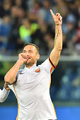Roma's Italian forward Francesco Totti celebrates after scoring a goal during the Italian Serie A football match between Genoa and AS Roma at Luigi...