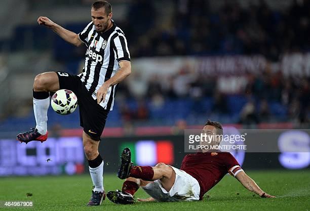 AS Roma's Italian forward Francesco Totti falls next to Juventus' Italian defender Giorgio Chiellini during the Italian Serie A football match...
