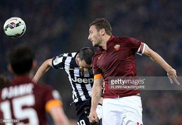 AS Roma's Italian forward Francesco Totti vies for the ball with Juventus' Italian defender Leonardo Bonucci during the Italian Serie A football...