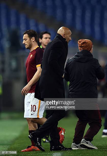 Roma's Italian forward Francesco Totti walks past Roma's Italian coach Luciano Spalletti during the Italian Serie A football match AS Roma vs ACF...