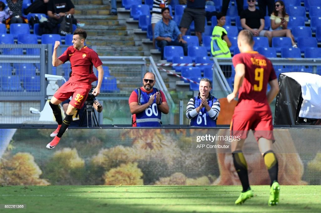 AS Roma's Italian forward Stephan el Shaarawy (L) celebrates after scoring against Udinese during the Italian Serie A football match between AS Roma and Udinese on September 23, 2017 at the Olympic stadium in Rome. / AFP PHOTO / Vincenzo PINTO