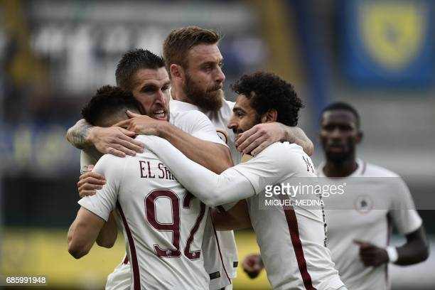 AS Roma's Italian forward Stephan El Shaarawy celebrates with teammates after scoring during the Italian Serie A football match Chievo vs AS Roma at...