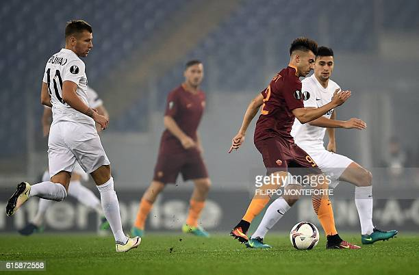 Roma's Italian forward Stephan El Shaarawy vies with Wien's Danish defnder Jens Stryger Larsen during the Europa League Group E football match...