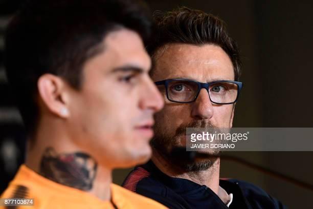 Roma's Italian head coach Eusebio Di Francesco and Roma's Argentinian midfielder Diego Perotti give a press conference at the Wanda Metropolitan...