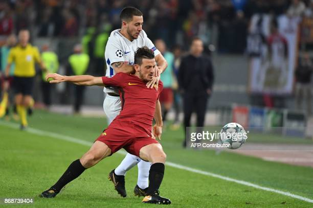 Roma's Italian midfielder Alessandro Florenzi fights for the ball with Chelsea's Belgian midfielder Eden Hazard during the UEFA Champions League...