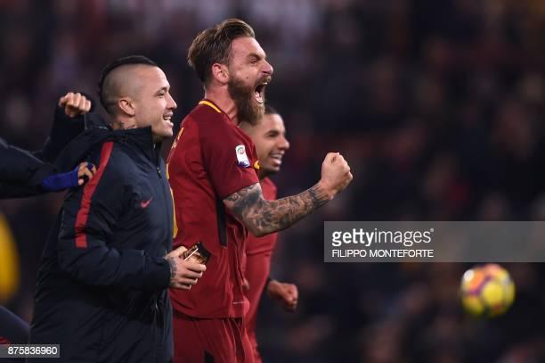 Roma's Italian midfielder Daniele De Rossi and Roma's Belgian midfielder Radja Nainggolan celebrate after winning the Italian Serie A football match...