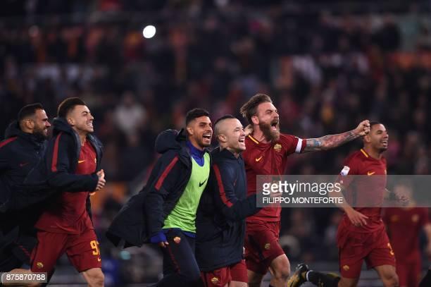Roma's Italian midfielder Daniele De Rossi and Roma's Belgian midfielder Radja Nainggolan celebrate with teammates after winning the Italian Serie A...