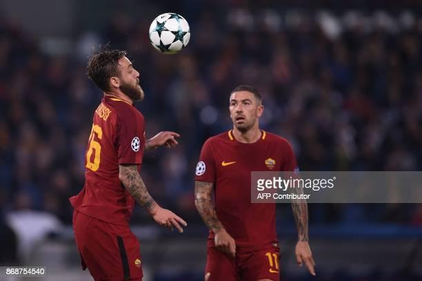 Roma's Italian midfielder Daniele De Rossi controls the ball next to Roma's Croatian defender Aleksandar Kolarov during the UEFA Champions League...