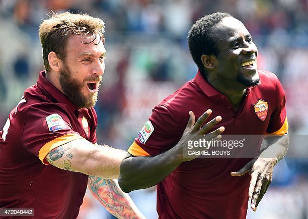 Roma's Ivorian midfielder Seydou Doumbia celebrates with Roma's forward Daniele De Rossi after scoring a goal during the Italian Serie A football...