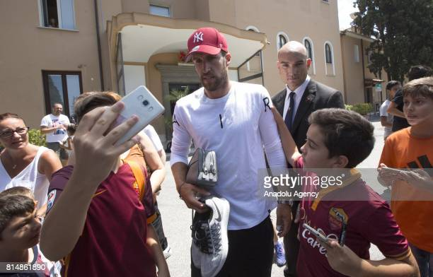 Roma's Kevin Strootman poses for a photo with fans as he leaves after attending medical check at Villa Stuart clinic in Rome Italy on July 15 2017
