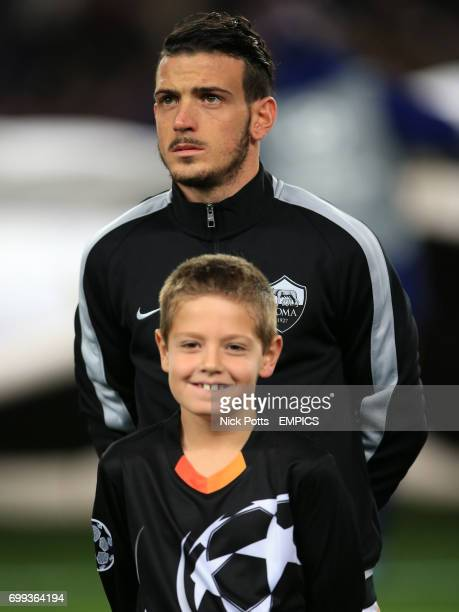 Roma's Kostas Manolas and a mascot