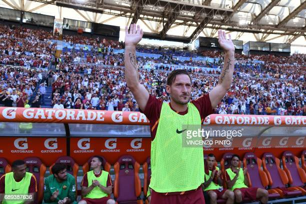 AS Roma's legend Francesco Totti greets fans before the Italian Serie A football match AS Roma vs Genoa on May 28 2017 at the Olympic Stadium in Rome...