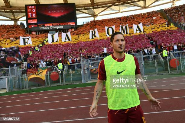 AS Roma's legend Francesco Totti poses with fans in the background before the Italian Serie A football match AS Roma vs Genoa on May 28 2017 at the...
