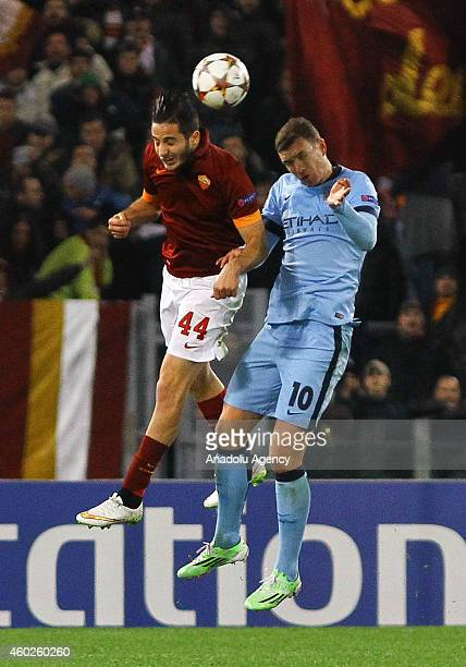 Roma's Manolas vies with Manchester City's Dzeko during the UEFA Champions League Group E match between AS Roma and Manchester City FC at Stadio...