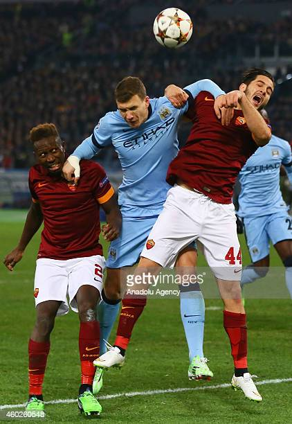 Roma's Mapou and Manolas vie with Manchester City's Dzeko during the UEFA Champions League Group E match between AS Roma and Manchester City FC at...