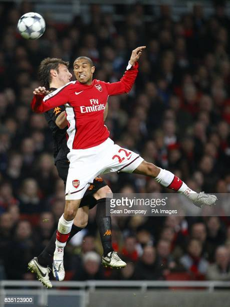 Roma's Marco Motta and Arsenal's Gael Clichy in action