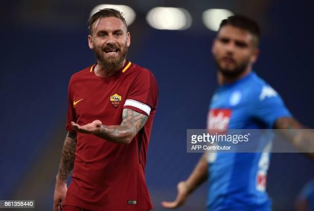 Roma's midfielder Daniele De Rossi and Napoli's forward Lorenzo Insigne react during the Italian Serie A football match Roma vs Napoli at the Olympic...