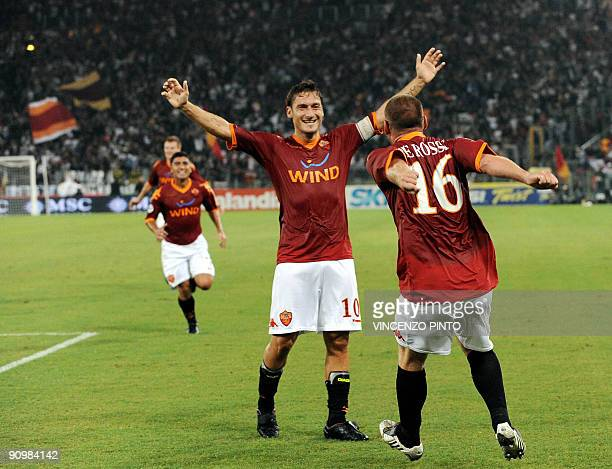 AS Roma's midfielder Daniele De Rossi celebrates with team forward Francesco Totti after scoring a goal against Fiorentina during their Serie A...