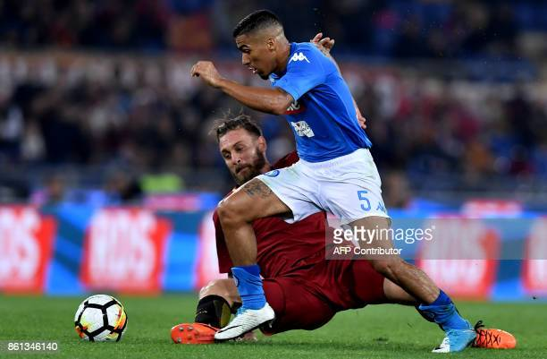 Roma's midfielder Daniele De Rossi fights for the ball with Napoli's Brazilian midfielder Allan during the Italian Serie A football match Roma vs...