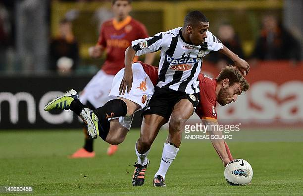 AS Roma's midfielder Daniele De Rossi fights the ball against Udinese forward Federico Fernandez of Capo Verde during the Italian Serie A football...
