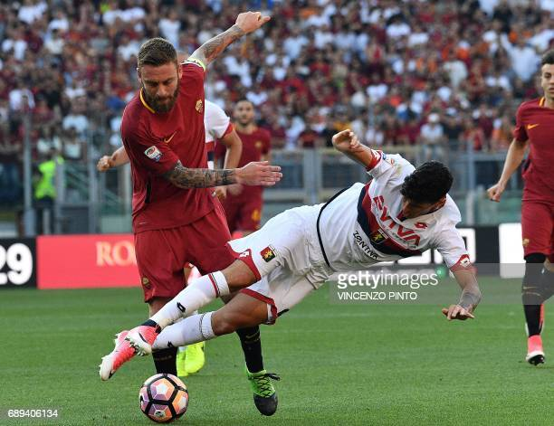 AS Roma's midfielder Daniele De Rossi vies with Genoa's defender Pietro Pellegri during the Italian Serie A football match AS Roma vs Genoa on May 28...