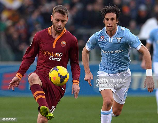AS Roma's midfielder Daniele De Rossi vies with Lazio's midfielder Stefano Mauri during the Italian Serie A football derby between Lazio Rome and AS...