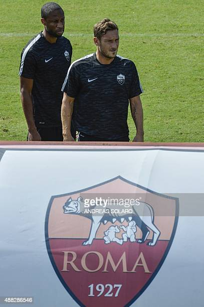 AS Roma's midfielder Francesco Totti and Seydou Keita take part in a training session on the eve of the team's Champions League football match...