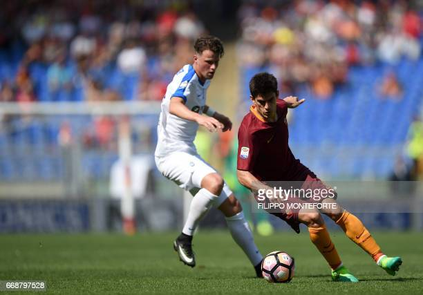 Roma's midfielder from Argentina Diego Perotti vies with Atalanta's defender from Brazil Rafael Toloi during the Italian Serie A football match AS...