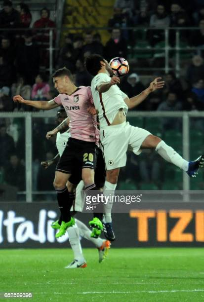 Roma's midfielder from Argentina Leandro Paredes fights for the ball with Palermo's forward Roland Sallai during the Italian Serie A football match...