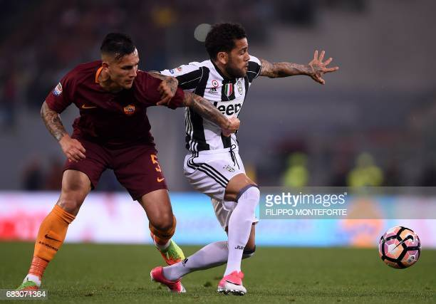 Roma's midfielder from Argentina Leandro Paredes vies with Juventus Defender from Brazil Dani Alves during the Italian Serie A football match Roma vs...