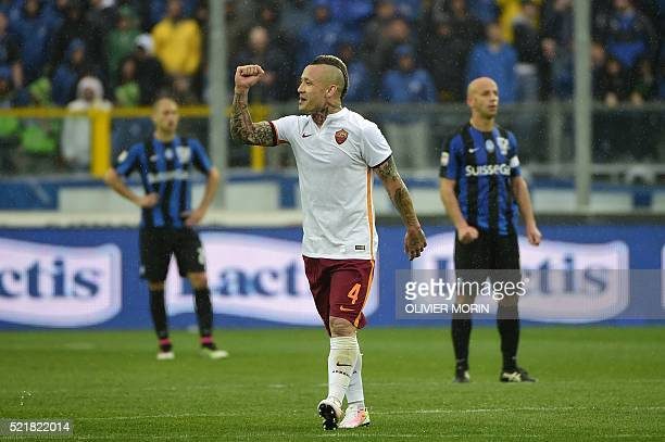 Roma's midfielder from Belgium Radja Nainggolan celebrates after scoring celebrates after scoring during the Italian Serie A football match Atalanta...