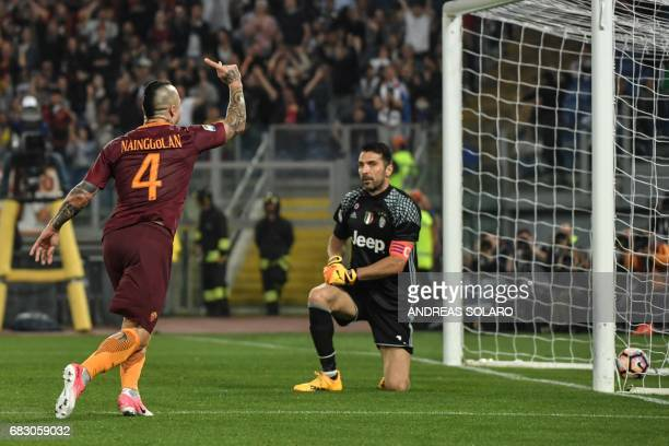 AS Roma's midfielder from Belgium Radja Nainggolan celebrates after scoring against Juventus' goalkeeper from Italy Gianluigi Buffon during the...