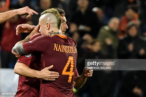 AS Roma's midfielder from Belgium Radja Nainggolan celebrates whit his teammate Francesco Totti after scoring during the Italian Serie A football...