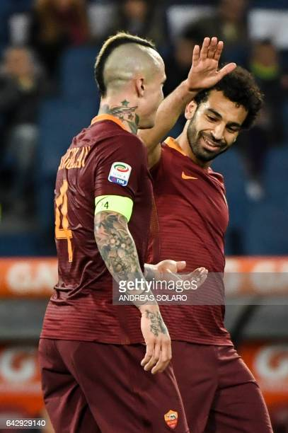 AS Roma's midfielder from Belgium Radja Nainggolan celebrates with his teammate AS Roma's midfielder from Egypt Mohamed Salah after scoring during...