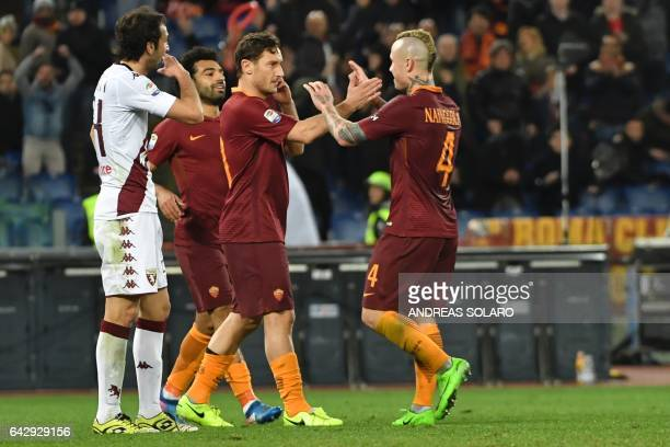 AS Roma's midfielder from Belgium Radja Nainggolan celebrates with his teammate Francesco Totti after scoring during the Italian Serie A football...